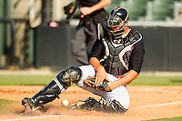 Kannapolis Intimidators catcher Kevan Smith #32 slides to block a throw during the South Atlantic League game against the Lexington Legends at CMC-Northeast Stadium on May 20, 2012 in Kannapolis, North Carolina.  The Legends defeated the Intimidators 7-1.  (Brian Westerholt/Four Seam Images)