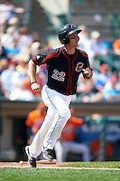 Rochester Red Wings catcher Eric Fryer (22) runs to first during a game against the Norfolk Tides on May 3, 2015 at Frontier Field in Rochester, New York.  Rochester defeated Norfolk 7-3.  (Mike Janes/Four Seam Images)