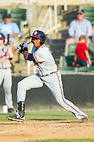 Carlos Franco (11) of the Rome Braves follows through on his swing against the Kannapolis Intimidators at CMC-Northeast Stadium on August 25, 2013 in Kannapolis, North Carolina.  The Intimidators defeated the Braves 9-0.  (Brian Westerholt/Four Seam Images)