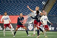 FOXBOROUGH, MA - OCTOBER 16: Thomas Roberts #23 of North Texas SC heads the ball during a game between North Texas SC and New England Revolution II at Gillette Stadium on October 16, 2020 in Foxborough, Massachusetts.