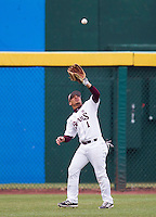 Keenen Maddox (1) of the Missouri State Bears catches a fly ball to left field during a game against the Northwestern Wildcats at Hammons Field on March 8, 2013 in Springfield, Missouri. (David Welker/Four Seam Images)