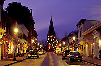 Annapolis, Maryland, MD, Christmas decorations along Main Street in downtown Annapolis in the evening. View of St. Anne's Church in the background.