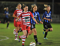 20131001 - VARSENARE , BELGIUM :  Antwerp Aafke Den Ridder (left) pictured with Brugge's Eva Van Daele during the female soccer match between Club Brugge Vrouwen and Royal Antwerp FC Ladies , of the fifth matchday in the BENELEAGUE competition. Tuesday 1 October 2013. PHOTO DAVID CATRY