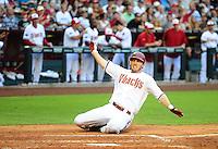 May 30, 2011; Phoenix, AZ, USA; Arizona Diamondbacks base runner Stephen Drew slides into home to score in the third inning against the Florida Marlins at Chase Field. Mandatory Credit: Mark J. Rebilas-