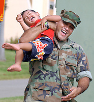 X.marines.1.0712.jl.jpg/photo lytle/Marine Sgt. Junior Roberts of Oceanside, plays with his two year old son Jadyn after reuniting with his family at Camp Pendleton Saturday morning after being deployed in Iraq for 6 months. (THIS IS LEDE ART)
