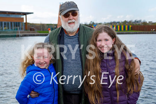 Mairead and Aine Dowling taking their granddad Martin Byrne for a walk in the Tralee Bay Wetlands on Friday.