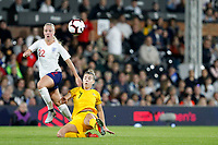 Stephanie Catley of Australia Women goes to ground to foil Beth Mead of England Women during the Women's international friendly match between England Women and Australia at Craven Cottage, London, England on 9 October 2018. Photo by Carlton Myrie / PRiME Media Images.