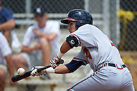 GCL Braves shortstop Alejandro Salazar (2) lays down a bunt during a game against the GCL Astros on July 23, 2015 at the Osceola County Stadium Complex in Kissimmee, Florida.  GCL Braves defeated GCL Astros 4-2.  (Mike Janes/Four Seam Images)