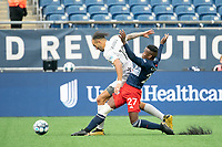 FOXBOROUGH, MA - APRIL 17: Luis Caicedo #27 of New England Revolution II tackles Hernan Gonzalez #19 of Richmond Kickers during a game between Richmond Kickers and Revolution II at Gillette Stadium on April 17, 2021 in Foxborough, Massachusetts.
