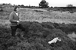 """Man out rabbit shooting with his Jack Russell dog. (Other image has two Jacks) He told me he normally gets about eight rabbits in an hour or so and sells them to his local skin merchant for eight shillings each. """"Its a good living,"""" he said. 1974 Suffolk East Angelia. UK. The UK went decimal in 1971, but he was still talking in pounds, shillings and pence!"""