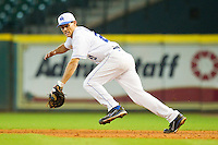 First baseman Luke Maile #21 of the Kentucky Wildcats chases after a ground ball against the Houston Cougars at Minute Maid Park on March 5, 2011 in Houston, Texas.  Photo by Brian Westerholt / Four Seam Images