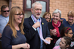 © Joel Goodman - 07973 332324 . 24/09/2016 . Liverpool , UK . JEREMY CORBYN is presented with a pink tie during a visit to Beaconsfield Community House in Birkenhead , following his victory declaration . The centre provides clothes and food that would otherwise be destined for waste from supermarkets , to local residents in need . Photo credit : Joel Goodman