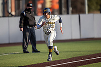 Michigan Wolverines outfielder Tito Flores (22) heads home during the NCAA baseball game against the Illinois Fighting Illini at Fisher Stadium on March 19, 2021 in Ann Arbor, Michigan. Illinois won the game 7-4. (Andrew Woolley/Four Seam Images)