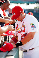 Matt Adams (25) of the Springfield Cardinals signs an autograph for a fan prior to a game against the Tulsa Drillers at Hammons Field on July 20, 2011 in Springfield, Missouri. Springfield defeated Tulsa 12-1. (David Welker / Four Seam Images)