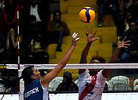 BOGOTÁ-COLOMBIA, 07-01-2020: Paula Nizetich de Argentina, remata el balón, a Angela Leyva de Perú, durante partido entre Argentina y Perú, en el Preolímpico Suramericano de Voleibol, clasificatorio a los Juegos Olímpicos Tokio 2020, jugado en el Coliseo del Salitre en la ciudad de Bogotá del 7 al 9 de enero de 2020. / Paula Nizetich from Argentina, shoots the ball, to Angela Leyva from Perú, during a match between Argentina and Peru, in the South American Volleyball Pre-Olympic Championship, qualifier for the Tokyo 2020 Olympic Games, played in the Colosseum El Salitre in Bogota city, from January 7 to 9, 2020. Photo: VizzorImage / Luis Ramírez / Staff.
