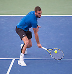 Benoit Paire (FRA) loses to Novak Djokovic (SRB), 7-5, 6-2 at the Western and Southern Open in Mason, OH on August 19, 2015.