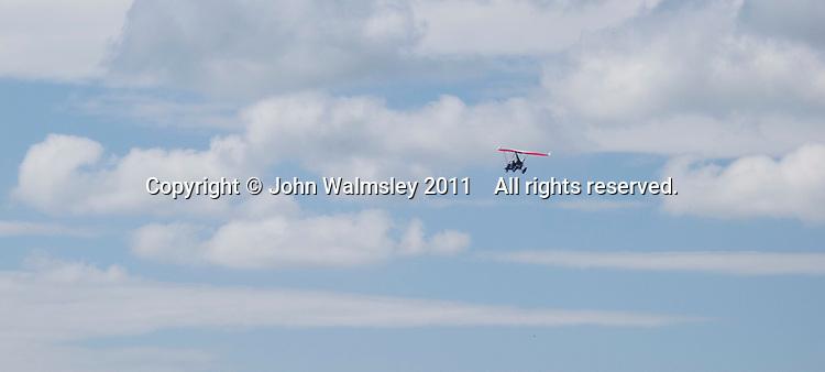 Microlight flying over Morecambe Bay, Lancashire, UK.