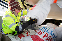 Volunteer Iditarod Air Force pilot, Dr. Bill Mayer loads musher drop bags into his plane at the Willow, Alaska airport during the Food Flyout on Saturday, February 20, 2016.  Iditarod 2016