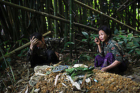 The family of Mee Xiong, a five year old child that was killed during a raid by the Lao People's Army, mourn at the child's grave in the Vientiane province of Laos on 27 November 2007. Thousands of Hmongs who fought or collaborated with the American CIA until communists took over the country in 1975 remain hidden in the jungles of Laos and are regular targets of the Lao People's Army