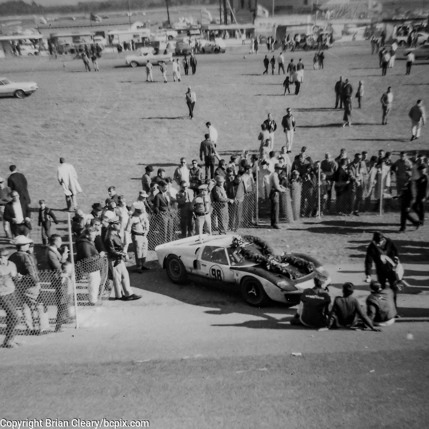 The #98 Ford GT40 of Ken Miles and Lloyd Ruby is shown in victory lane after winning the 1966 24 Hours of Daytona at Daytona International Speedway in Daytona Beach, Florida.  (Photo by Brian Cleary/bcpix.com)