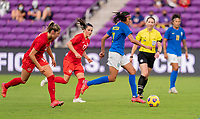 ORLANDO, FL - FEBRUARY 24: Andressa #7 of Brazil dribbles during a game between Brazil and Canada at Exploria Stadium on February 24, 2021 in Orlando, Florida.