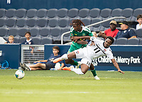 KANSAS CITY, KS - JUNE 26: Daniel Kadell #3 and Levi Garcia #11 battle for the ball during a game between Guyana and Trinidad