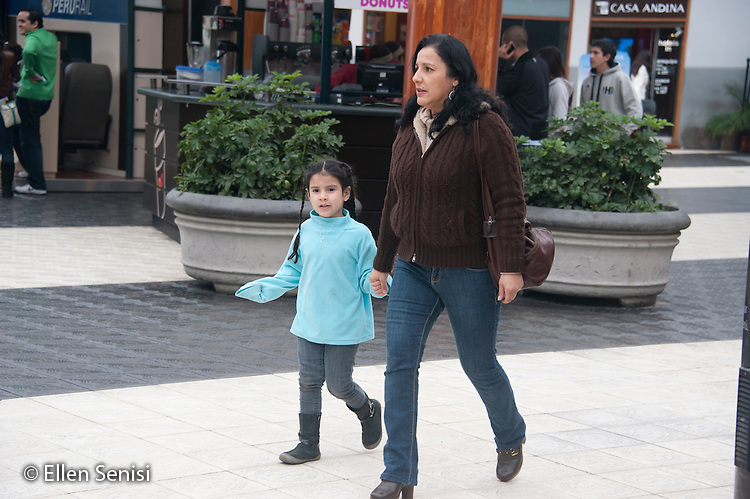 Lima, Peru. Miraflores district, Larcomar Mall.  Mother and daughter together in mall. No MR. ID: AL-peru.