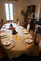 Mas de Perry, Mas Nicot. Terrasses de Larzac. Languedoc. Lunch table set for an opulent meal. France. Europe. In the dining room.