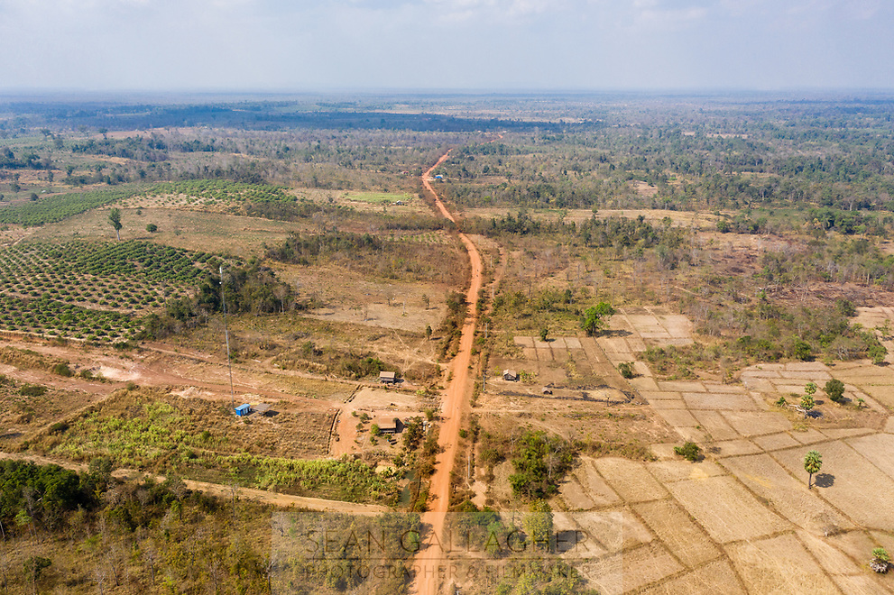 A road running though the Beng Per Wildlife Sanctuary, in northern Cambodia. The sanctuary is a sanctuary in name only as most of the land has been sold by the government for agricultural concessions. The South East Asian country has one of the fastest rates of deforestation in the world and it is estimated only 3% of primary forest is left throughout the country. Forest clearance is fuelled by demand for agricultural land and high value species of tree for the Asian furniture market.
