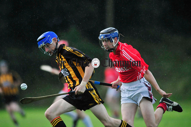 Ballyea's Eamon Griffin sets up an attack under pressure from Eire Og's Neil O' Loughlin. Photograph by Declan Monaghan