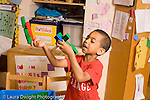 Preschool ages 3-5 imaginary play boy moving airplanes he constructed from Duplo bricks talking and making sounds horizontal