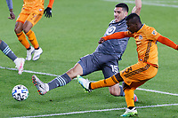 ST PAUL, MN - OCTOBER 18: Darwin Quintero #23 of Houston Dynamo kicks the ball past Michael Boxall #15 of Minnesota United FC during a game between Houston Dynamo and Minnesota United FC at Allianz Field on October 18, 2020 in St Paul, Minnesota.