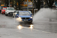 Pictured: A car travels through a flooded area in Walter Road, Swansea, south Wales, UK. Saturday 15 February 2020<br /> Re: Strong winds and heavy rain caused by storm Dennis has been affecting parts of the UK.