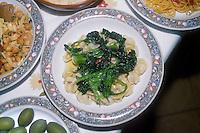 """- cucina tipica italiana, orecchiette con i broccoli....- Italian food , typical kitchen of the Puglia ( Apulia ) region, pasta """" orecchiette """" with vegetables"""