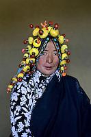 Woman wearing amber, Kham, Eastern Tibet, 2006