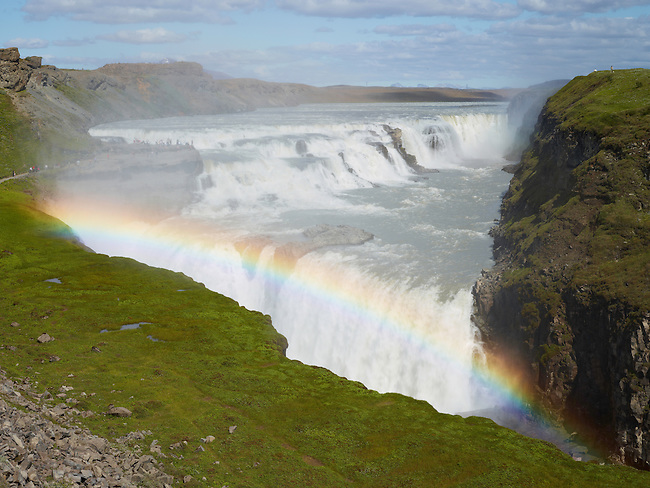 The Gullfoss waterfall, one of Iceland's largest and most impressive, appears to swallow the river in a giant hole in the earth.