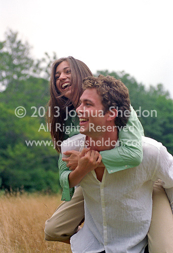 Young man giving a woman a piggy back ride.