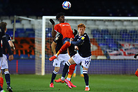 23rd February 2021; Kenilworth Road, Luton, Bedfordshire, England; English Football League Championship Football, Luton Town versus Millwall; Ryan Woods of Millwall fouls Elijah Adebayo of Luton Town as they challenge for a header