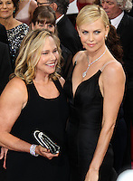 HOLLYWOOD, LOS ANGELES, CA, USA - MARCH 02: Gerda Maritz, Charlize Theron at the 86th Annual Academy Awards held at Dolby Theatre on March 2, 2014 in Hollywood, Los Angeles, California, United States. (Photo by Xavier Collin/Celebrity Monitor)