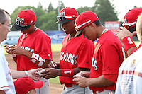 Batavia Muckdogs outfielder Reggie Williams, Cesar Valera, and Romulo Ruiz sign autographs during the teams pre-season pep rally at Dwyer Stadium on June 15, 2011 in Batavia, New York.  Photo By Mike Janes/Four Seam Images