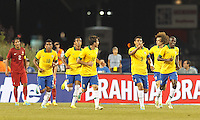 Brazil defender Thiago Silva (3) celebrates his goal with teammates. In an international friendly, Brazil (yellow/blue) defeated Portugal (red), 3-1, at Gillette Stadium on September 10, 2013.
