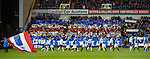 Rangers fans provide some colour as the teams emerge at Ibrox