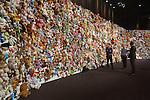 Three unidentified men look at the wall of compassion prior to a commemoration ceremony in Nieuwegein, near the central city of Utrecht, Netherlands, Thursday, July 16, 2015.REUTERS/Michael Kooren/Pool <br /> The wall of compassion consists of thousands of dolls found along the road and at schiphol airport. <br /> NOT to be published before July 17 12:00  Noon  local time ( It is a surprise for the families.)