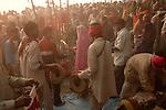 Hindu pilgrims are worshiping sun god on the bank of Gandak river during Sonepur fair. Bihar, India, Arindam Mukherjee.