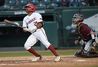 Arkansas center fielder Christian Franklin hits an RBI double scoring first baseman Brady Slavens Tuesday, April 6, 2021, during the third inning of play against UALR at Baum-Walker Stadium in Fayetteville. Visit nwaonline.com/210407Daily/ for today's photo gallery. <br /> (NWA Democrat-Gazette/Andy Shupe)