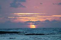 An ocean sunrise in Kapoho off the eastern side of the island of Hawai'i. The black rocks in the foreground are from a 1960 eruption that covered a small Hawaiian sugar plantation in Kapoho...and then flowed into the ocean.