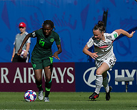 GRENOBLE, FRANCE - JUNE 22: Ngozi Okobi #13 of the Nigerian National Team dribbles as Marina Hegering #5 of the German National Team closes during a game between Panama and Guyana at Stade des Alpes on June 22, 2019 in Grenoble, France.