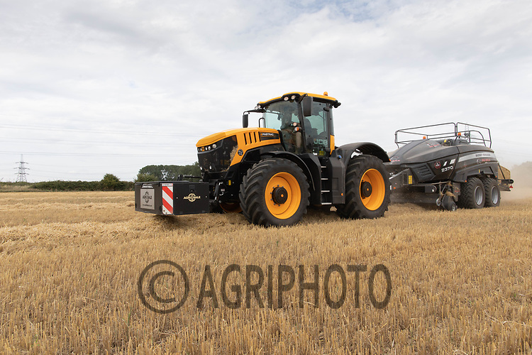 23.7.2020 Contractors baling Barley straw in Cambridgeshire. <br /> ©Tim Scrivener Photographer 07850 303986<br />      ....Covering Agriculture In The UK.
