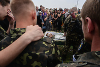 Relatives, friends and soldiers mourn  Pro-Russian activist Alexander Gizay exposed in his coffin at funerals of eight murdered by Ukraine army airstrike on Lugansk.