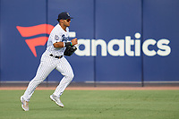 Tampa Tarpons outfielder Jasson Dominguez (20) jogs to the dugout during a game against the Lakeland Flying Tigers on July 15, 2021 at George M. Steinbrenner Field in Tampa, Florida.  (Mike Janes/Four Seam Images)